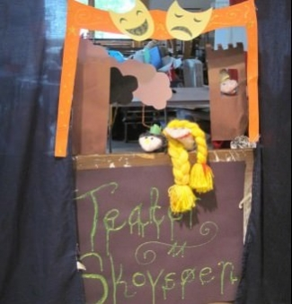 <p>Villagers recreating a Hans Christian Andersen story as a puppet show.</p>