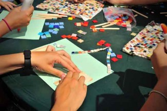 <p>Villagers take part in an art activity.</p>